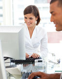 Two colleagues working at a their computer Royalty Free Stock Photo