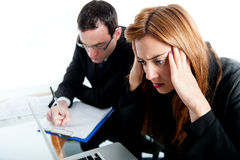 Two colleagues working together and getting stressed Stock Photo