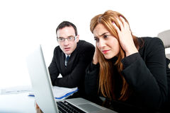 Two colleagues working together and getting stressed Stock Images