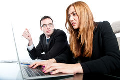 Two colleagues working together and getting stressed Royalty Free Stock Images