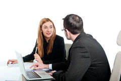 Two colleagues working together on a laptop computer Stock Images