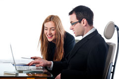 Two colleagues working together on a laptop computer Stock Image