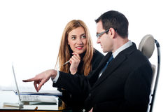 Two colleagues working together on a laptop computer Royalty Free Stock Photography