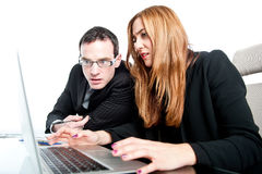 Two colleagues working together on a laptop Royalty Free Stock Photo