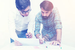 Two colleagues working together at office, toned Stock Photography