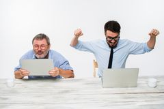 The two colleagues working together at office on white background Stock Photography