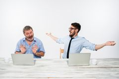 The two colleagues working together at office on white background Royalty Free Stock Photo