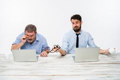 The two colleagues working together at office on white background Royalty Free Stock Photos