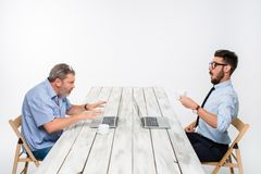 The two colleagues working together at office on white background Stock Image