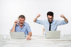 The two colleagues working together at office on white background Royalty Free Stock Images