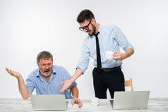 The two colleagues working together at office on white background Royalty Free Stock Photography