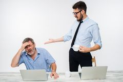 The two colleagues working together at office on white background Royalty Free Stock Image