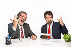 The two colleagues working together at office on white background. Royalty Free Stock Photography