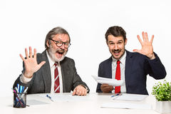 The two colleagues working together at office on white background. Stock Image