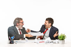 The two colleagues working together at office on white background. Royalty Free Stock Photos