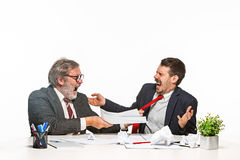 The two colleagues working together at office on white background. Stock Photos
