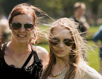 Two college girls with sunglasses. SZCZECIN, POLAND - MAY 23, 2014: Juwenalia, is an annual students' holiday in Poland, usually celebrated for three days in Stock Images