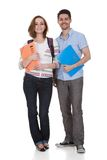 Two college student holding folder. Happy College Student Holding Folder Isolated Over White Background Stock Image