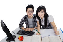 Two college student learn on table Stock Photo
