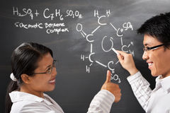 Two college student solving chmestry problem Stock Photography