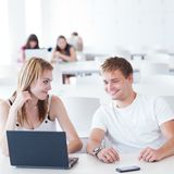Two college students having fun studying together Royalty Free Stock Images