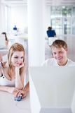 Two college students having fun studying together Stock Photography