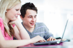 Two college students having fun studying together Stock Photos