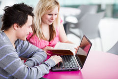 Two college students having fun studying together Royalty Free Stock Photography
