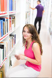 Two college students in library Royalty Free Stock Images