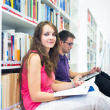 Two college students in library Stock Photography
