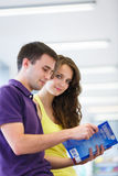 Two college students in library Royalty Free Stock Image