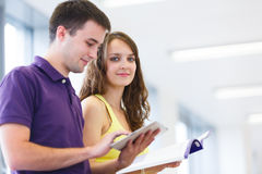 Two college students in library Stock Images