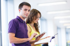 Two college students in library Royalty Free Stock Photography