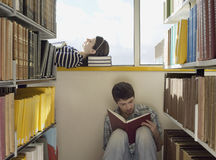 Two College Students Reading in Library Stock Photography