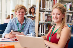 Two College Students Studying In Library Together Stock Photos