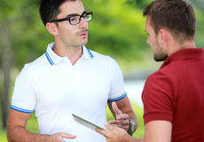 Two college students studying together at college park Royalty Free Stock Photos