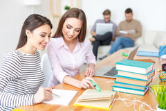 Two college students studying together at home Royalty Free Stock Images