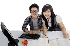 Two college students studying together on studio Stock Image