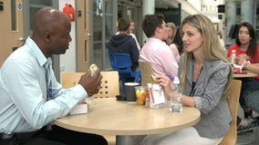 Two College Tutors Eating Lunch Together stock footage