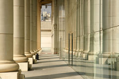 Two colonnades. Colonnade and its reflection in the window of a building in Barcelona Royalty Free Stock Photo