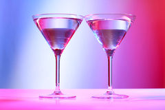 Two colop martini glasses Stock Images