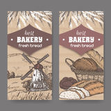 Two color bakery labels with windmill, wheat, bread on cardboard. Stock Photos
