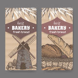 Two color bakery templates with stone windmill, wheat and bread. Royalty Free Stock Photography