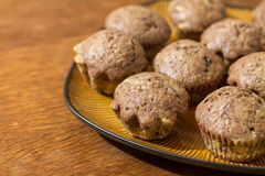 Two-color chocolate muffins in brown plate Royalty Free Stock Images