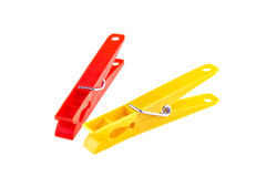 Two color clothes-pegs over white Royalty Free Stock Image