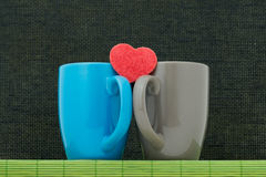 Two color cups and heart Stock Photo