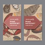 Two color fish market label templates with fish, lobster, seafood. Set of two color fish market label templates with fish, lobster and seafood on black Royalty Free Stock Photo
