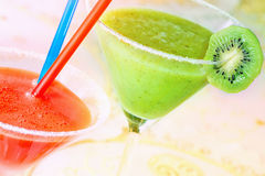 Two of color fruit drinks Royalty Free Stock Photos