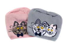 Two color knit cap with a pattern of a cat. Royalty Free Stock Images