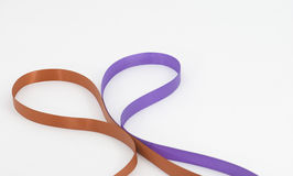 Two color ribbons forming heart shape Royalty Free Stock Image